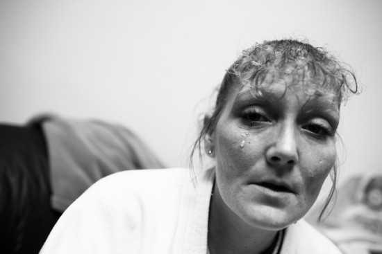 Deanna, 33, cries in her temporary housing provided by the Salvation Army Shelter in Newark, Ohio. She has been physically abused by her husband. She lost custody on her son, and even though she went through a substance abuse treatment program, she could not stop abusing alcohol. Hall is on the waiting list for another substance abuse treatment program.