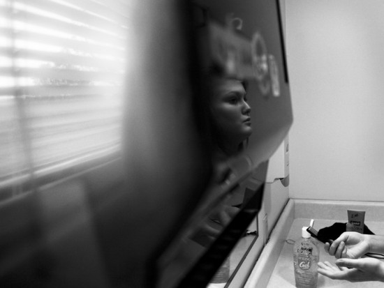 Kristen, 20, a client at the Rural Women's Recovery Program in Athens, Ohio, is about to brush her hair in the bathroom.
