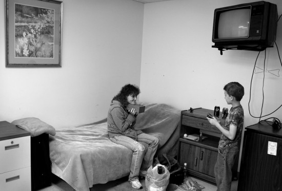 Deanna, 33, welcomes her son Kehnan, 10, at her temporary housing at the Salvation Army shelter in Newark, Ohio. Deanna has been physically abused by her husband. She lost custody on her son, and even though she went through a substance abuse treatment program, she could not stop abusing alcohol.