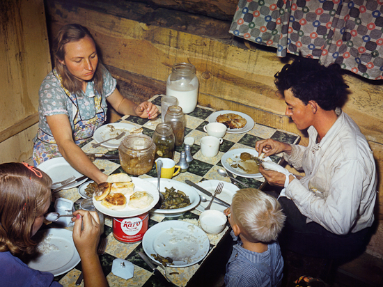 The Fae and Doris Caudill family eating dinner in their dugout.