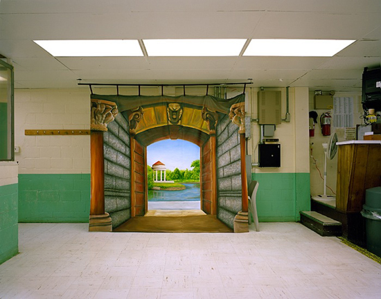 Alyse Emdur. Backdrop painted by Darrell Van Mastrigt in Graterford Correctional Institution,Pennsylvania, 2011. From the series Prison Landscapes (2008-2011).