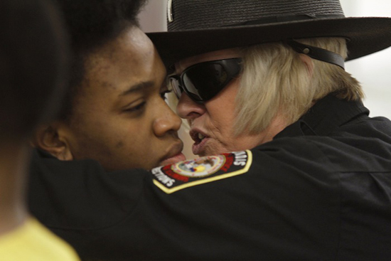 Julia Rendleman. Lieutenant Valestin interrogates inmate Catherine Thomas, March 18, 2010, intake day, at the Dixon Springs boot camp in southern Illinois.Credit Julia Rendleman/Reportage by Getty Images.