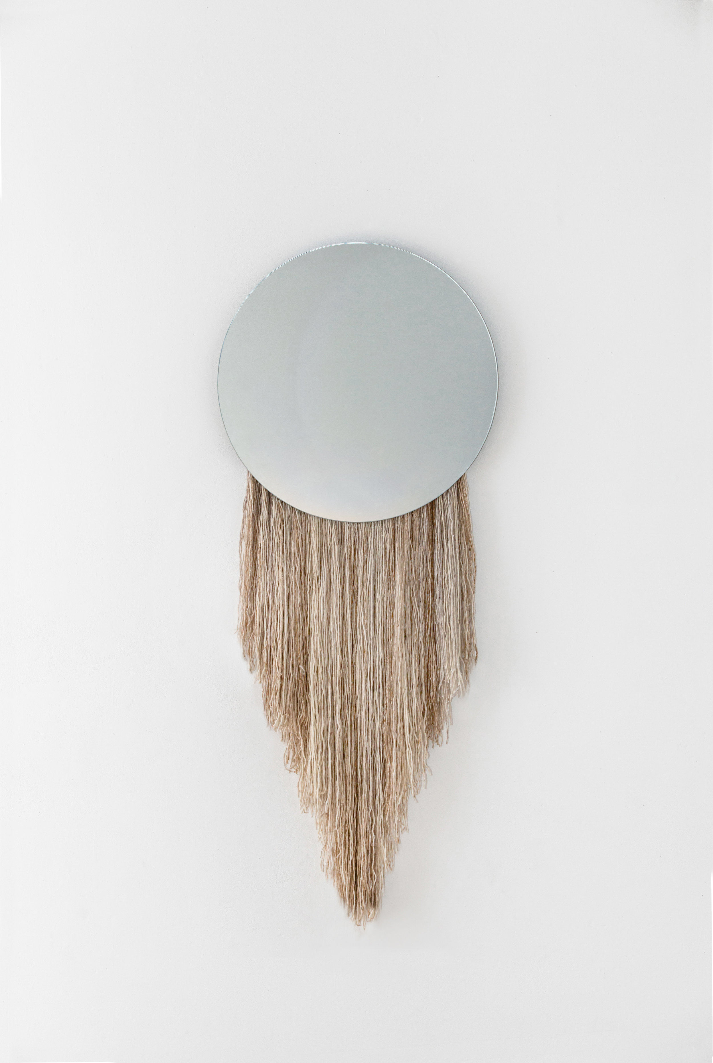 EOS, mirror embellished with fiber named after the ancient Greek goddess Dawn