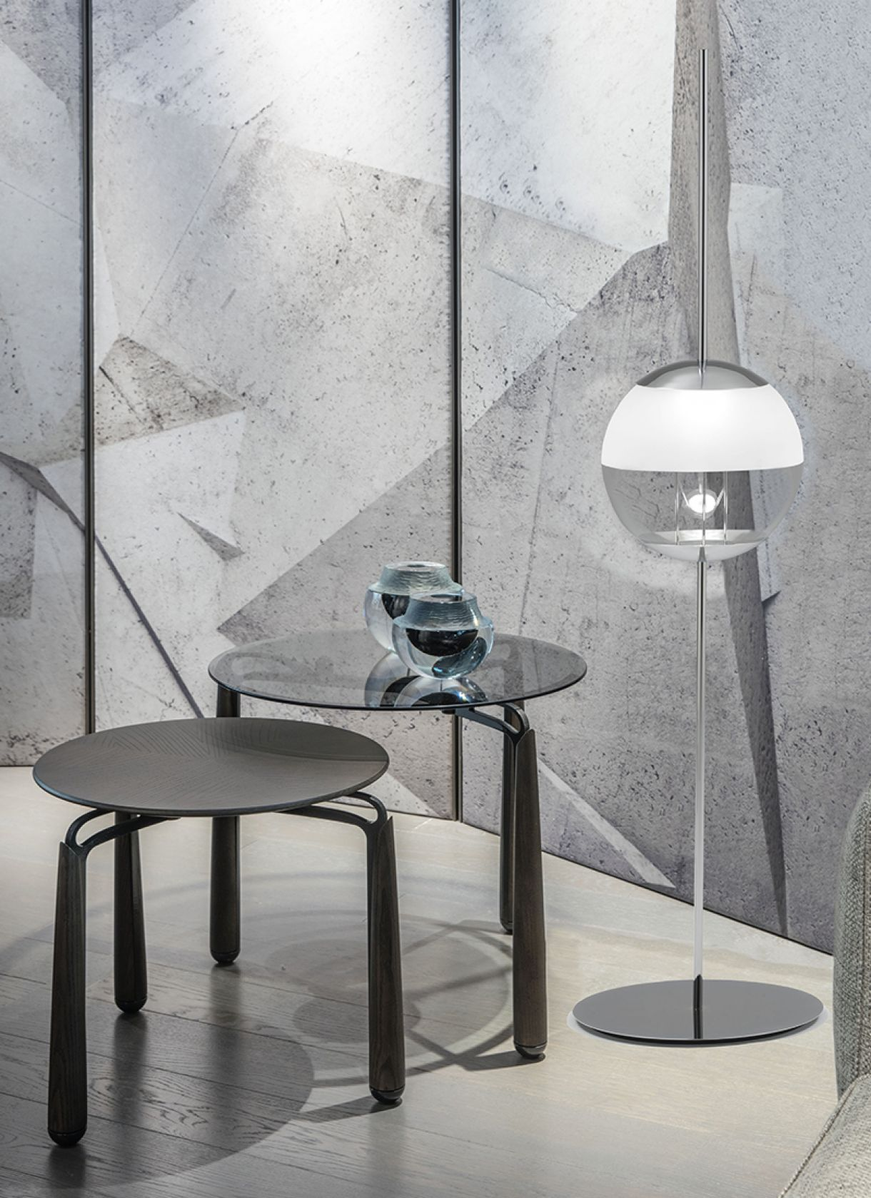 Christie, floor lamp with suspended sphere drawing ambient lighting along a metaphysical rhythm