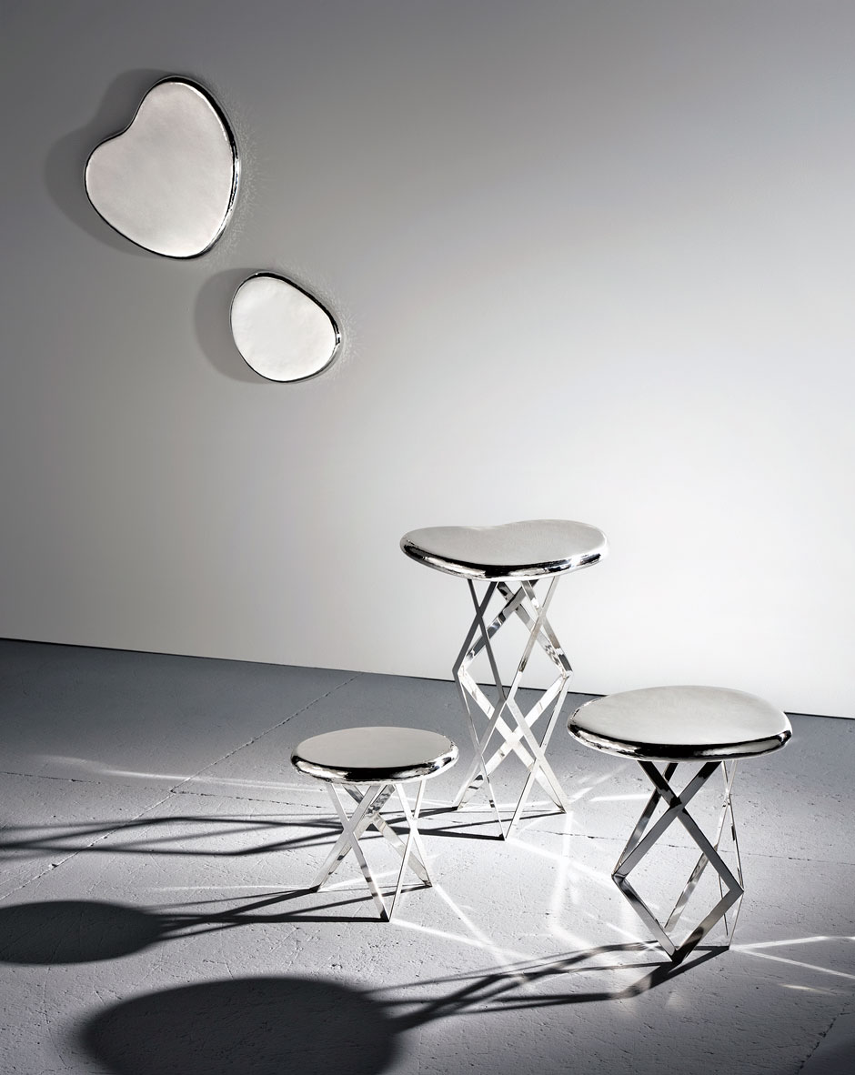 Table / Jahara studio, silver color, solid structure and smooth surface