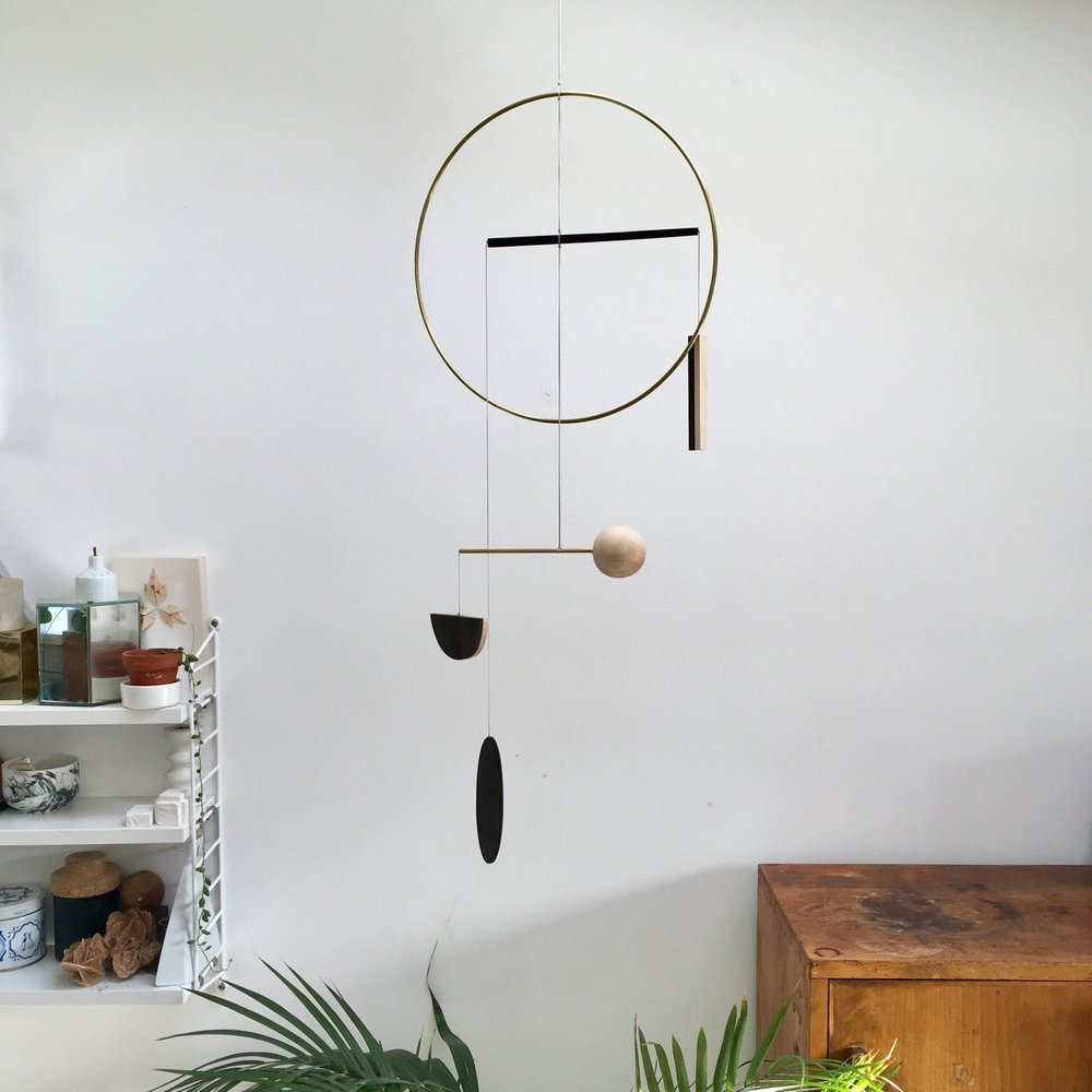 Corrie Williamson mobile / wood and brass