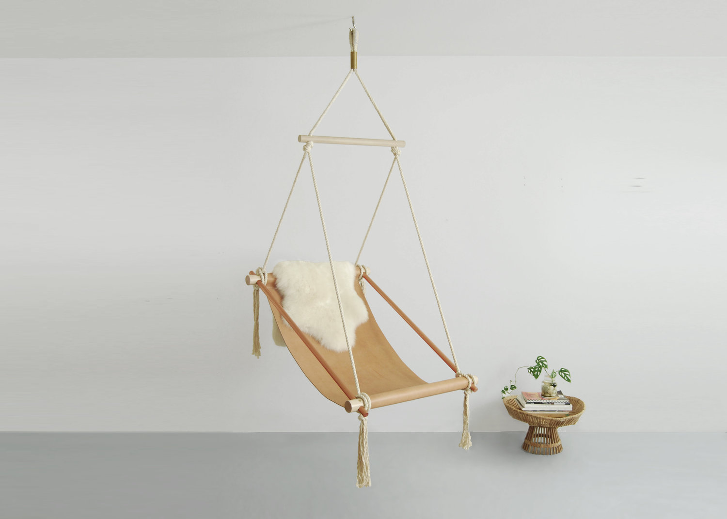 Ovis, suspended wooden chair, metal, leather and cotton rope