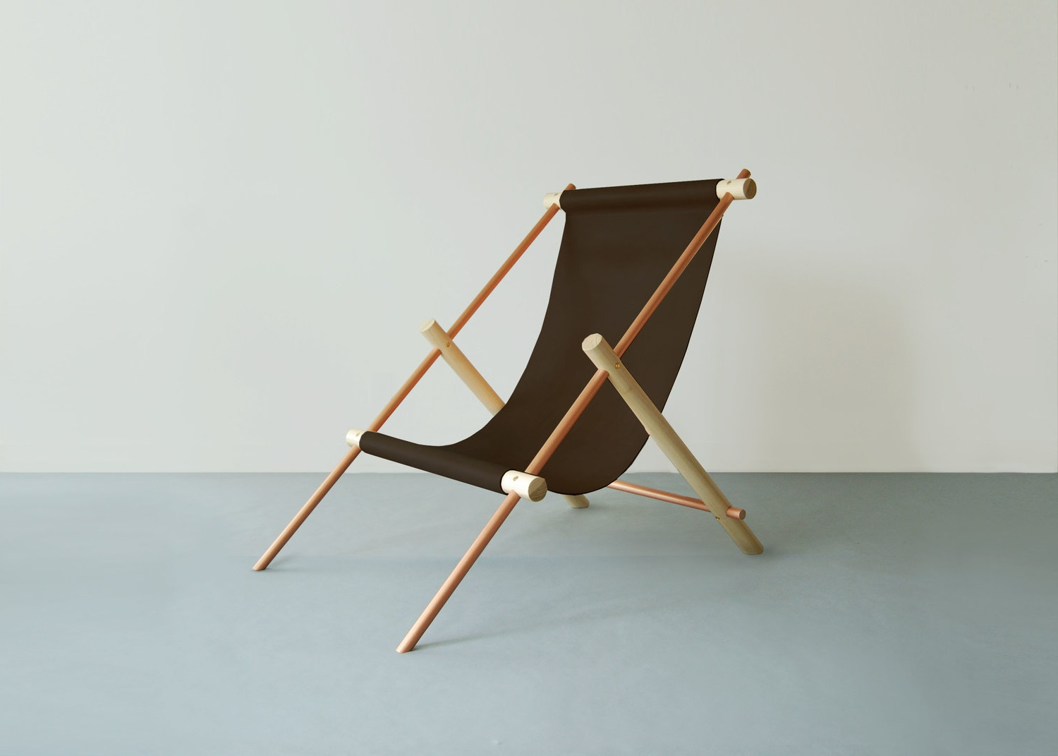 Ovis, lounge chair in wood, metal and leather