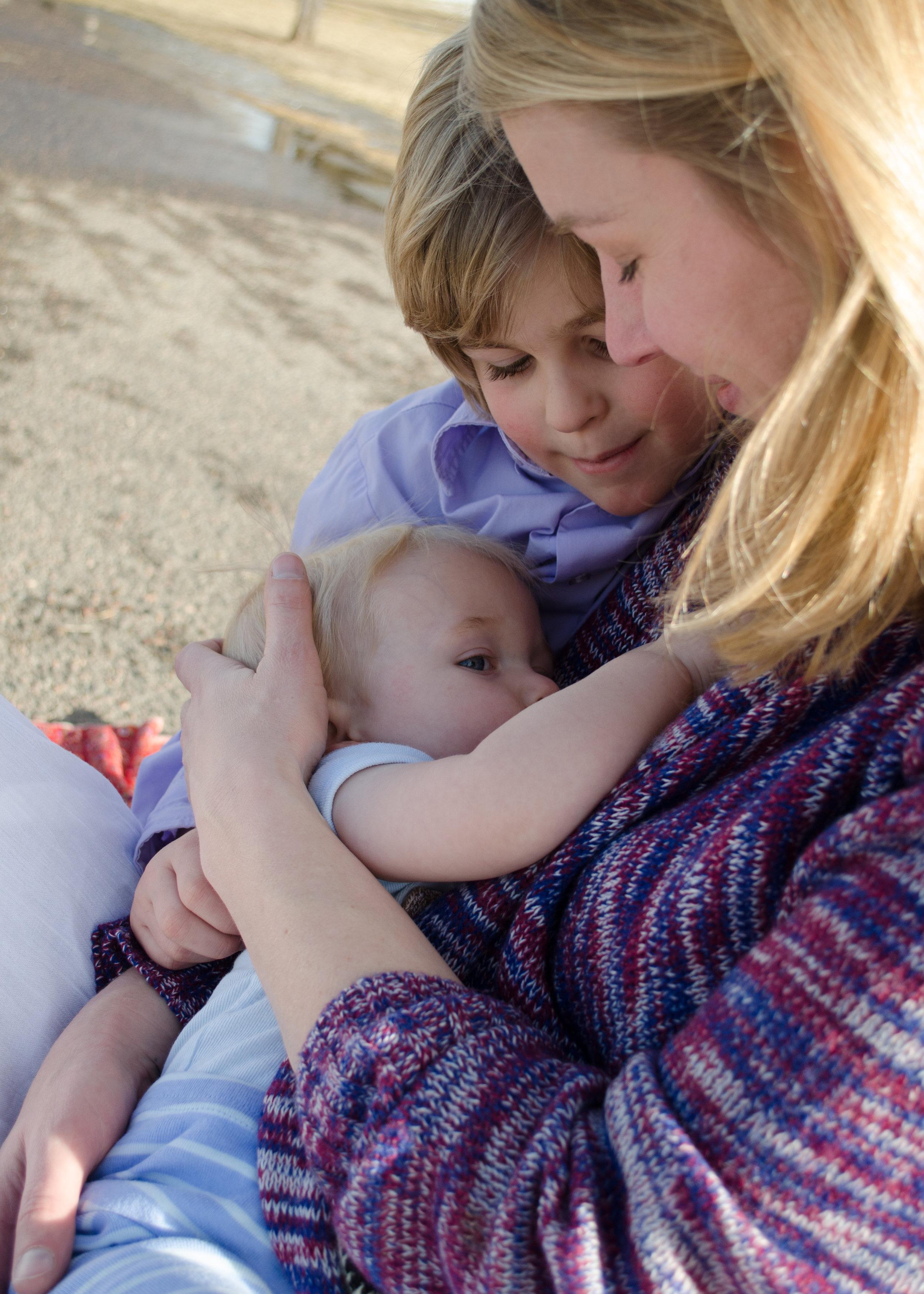 Family breastfeeding, love all around