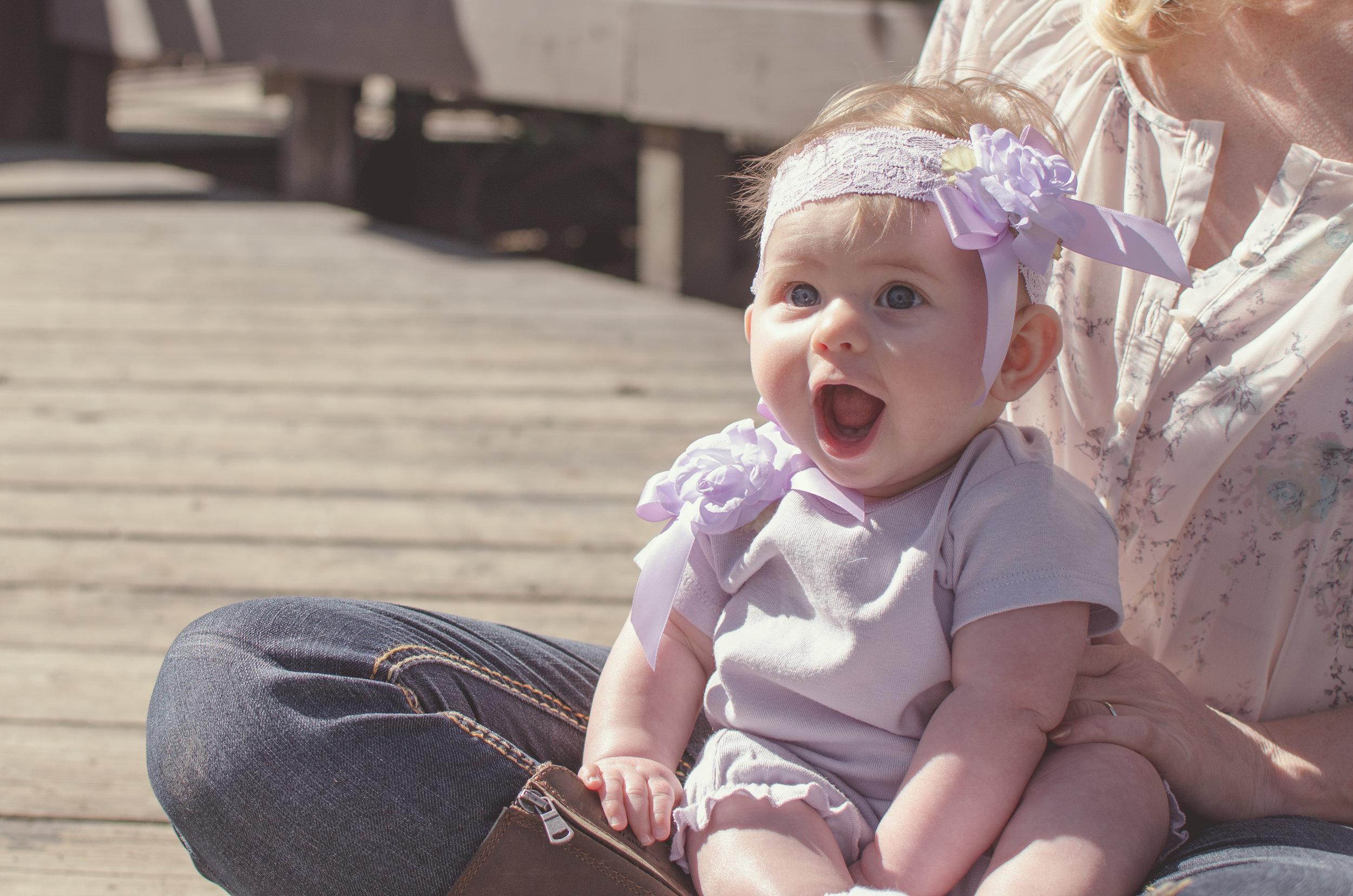 Surprised and happy kiddo, breastfeeding