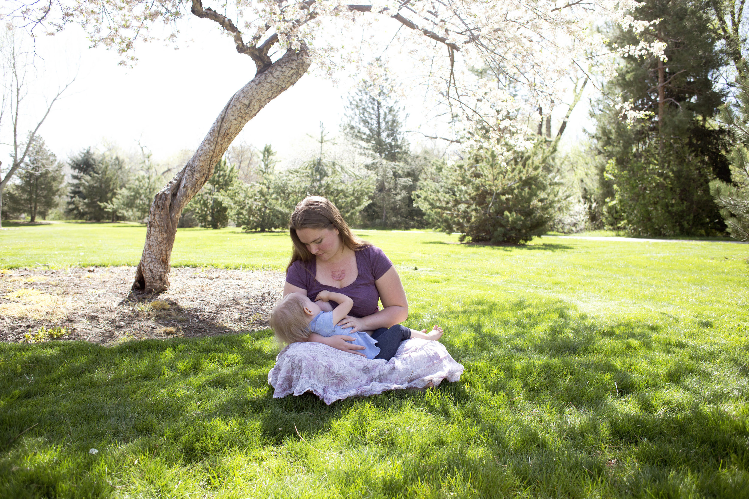 Breastfeeding in a park, mommy and me, spring