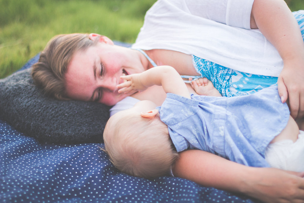 Laying down breastfeeding, happy mom, love and play