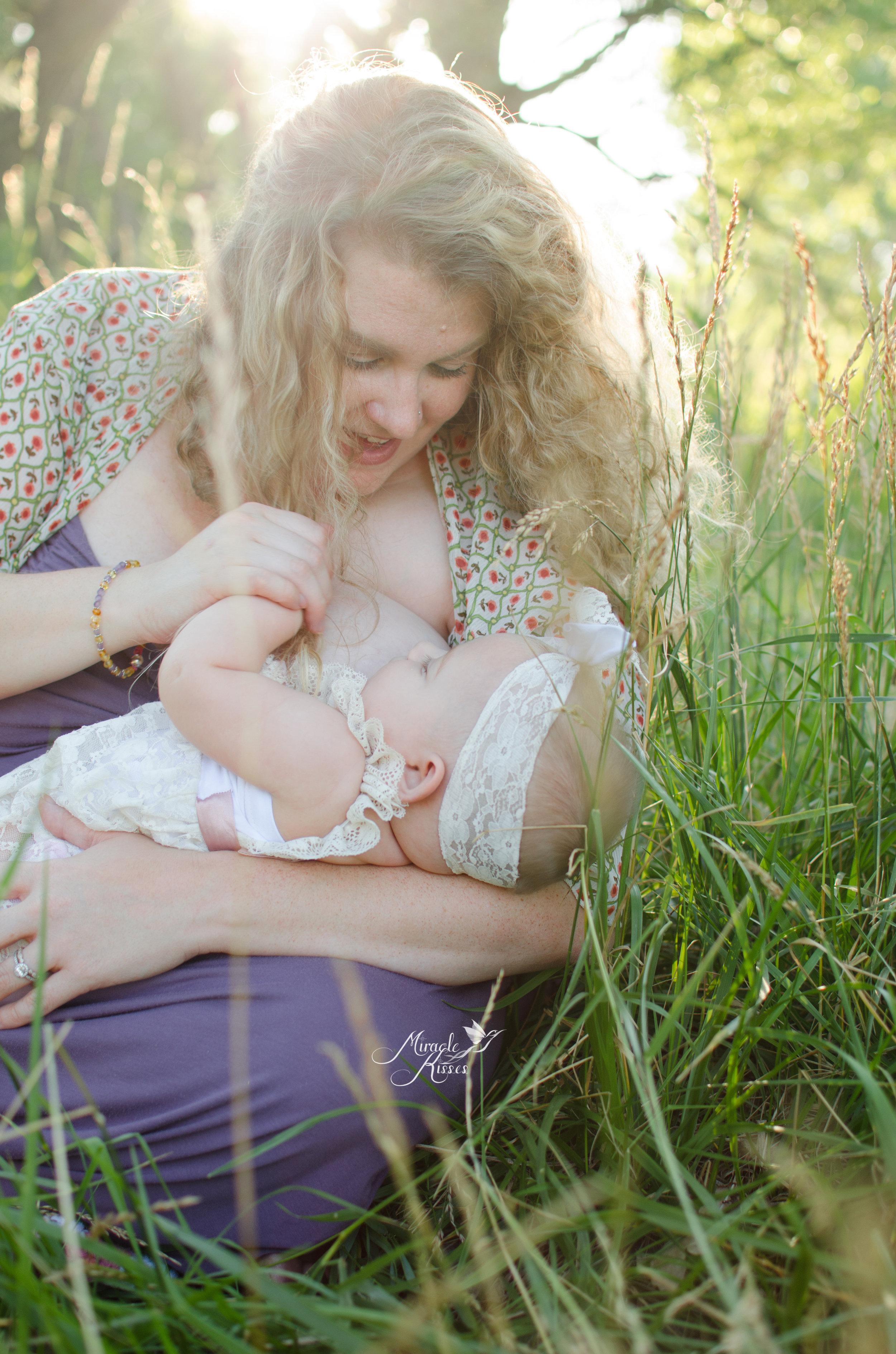 Breastfeeding in the grass, beautiful light, 31 days 31 stories