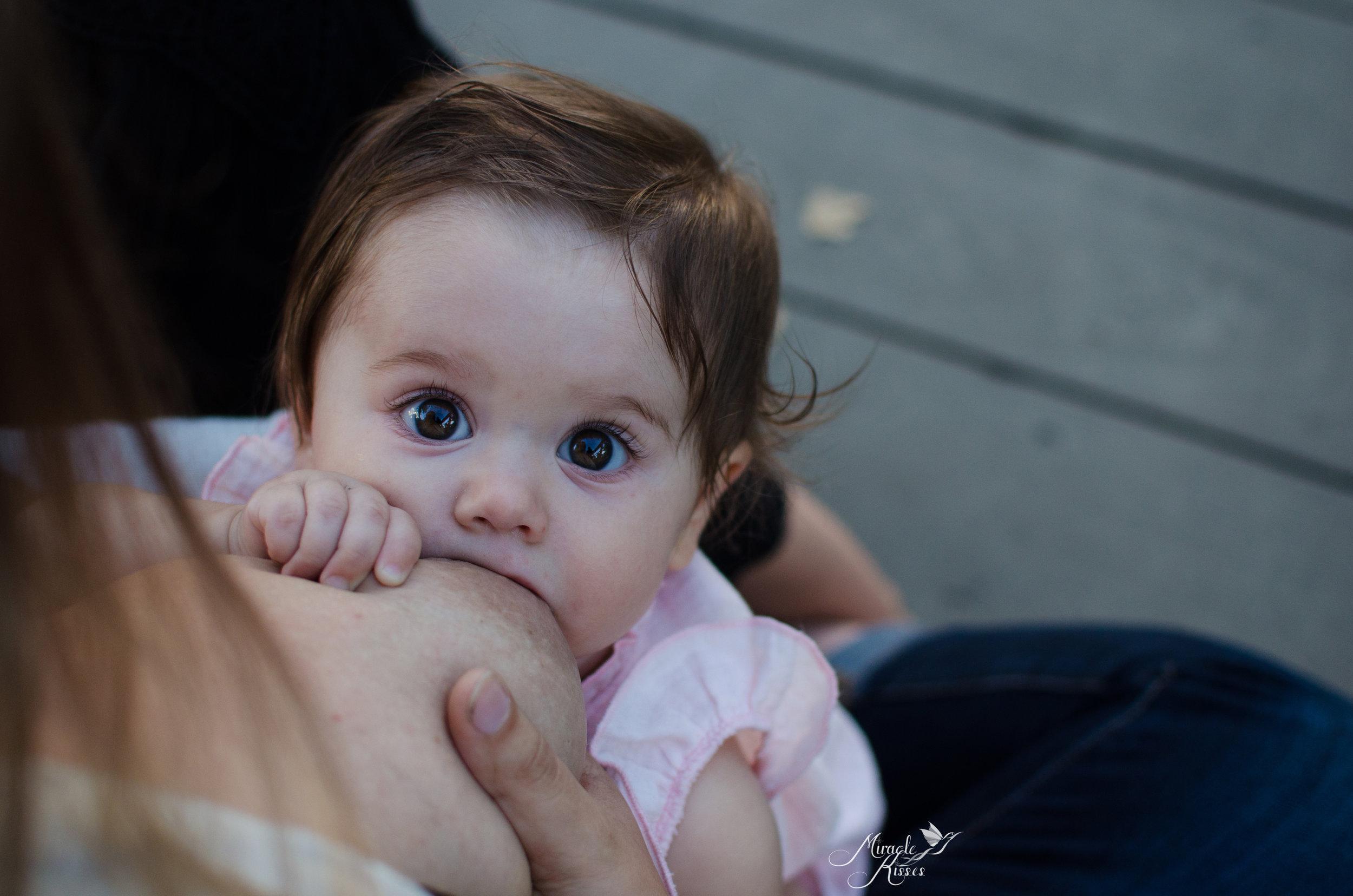 brown eyed beauty, acrobatic nursing, wheat ridge breastfeeding