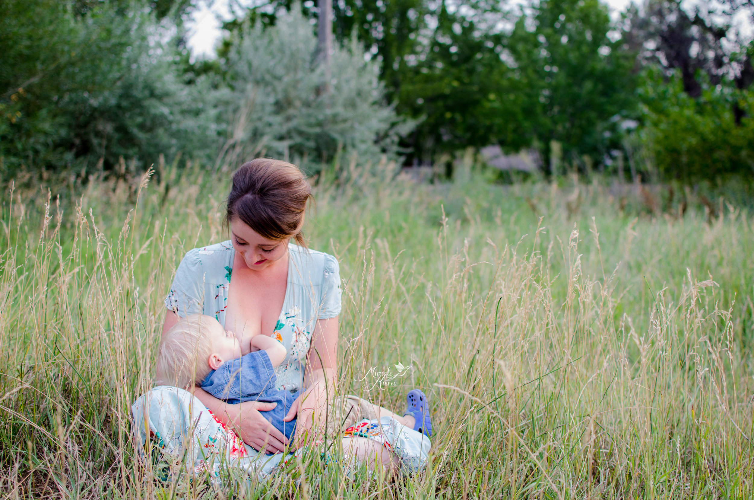 breastfeeding in the grass, normalize breastfeeding, mother and son photo