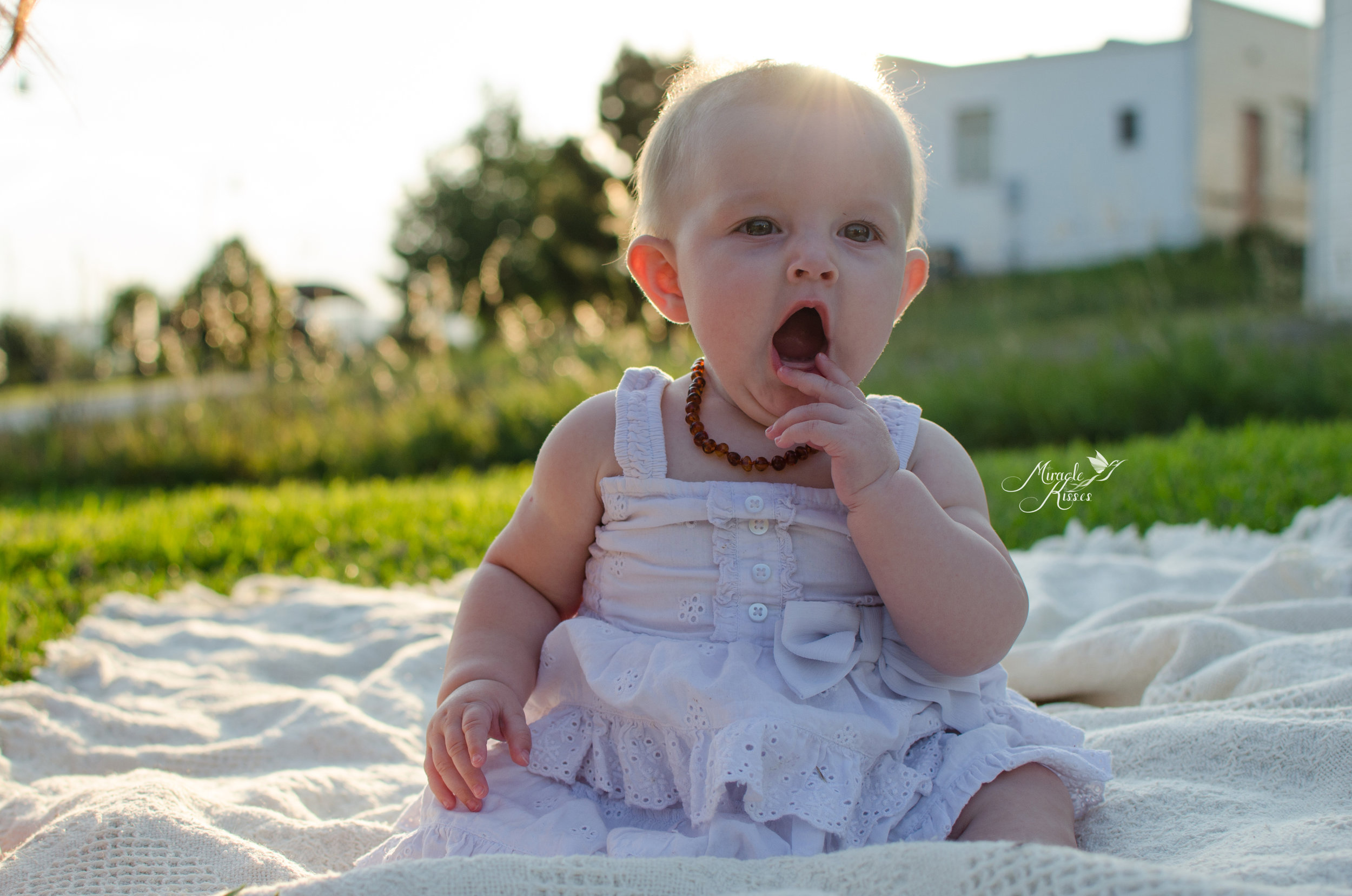 yawning kiddo, milestone photo, nursing story