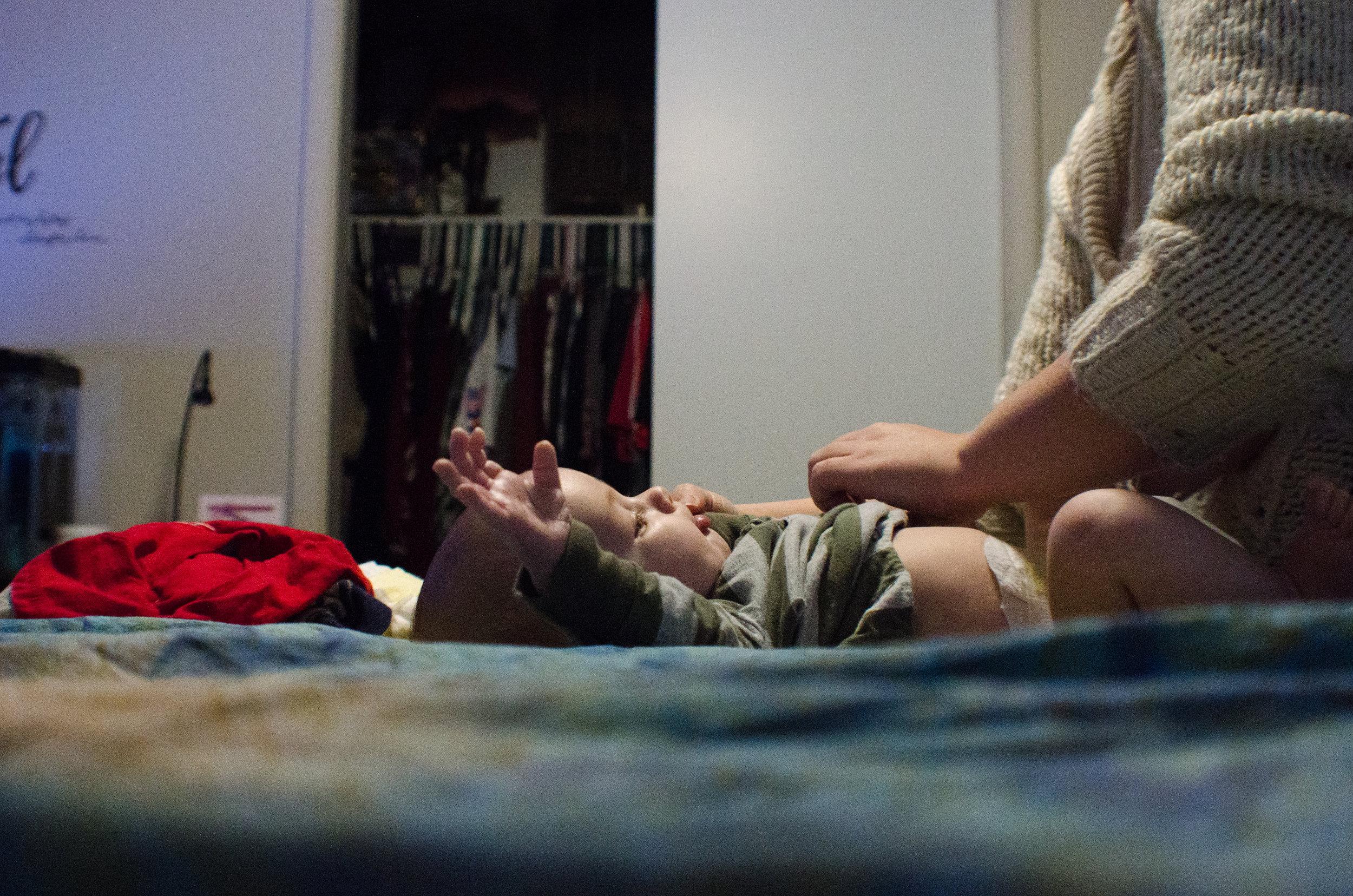 change the diaper, real life photo, motherhood, colorado photographer