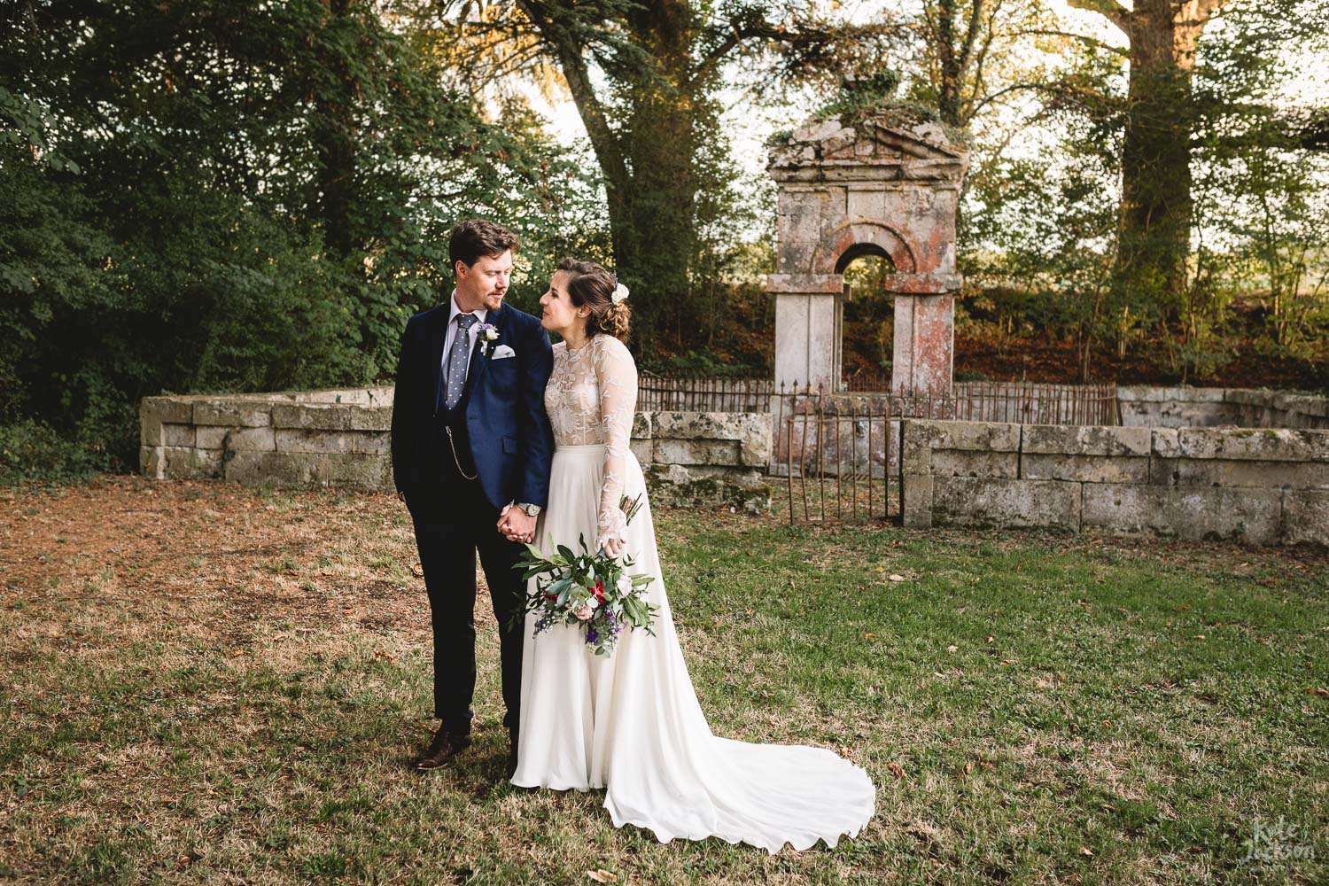 Bride and Groom stood together in woods in France, Chateau Lasfarages Destination Wedding