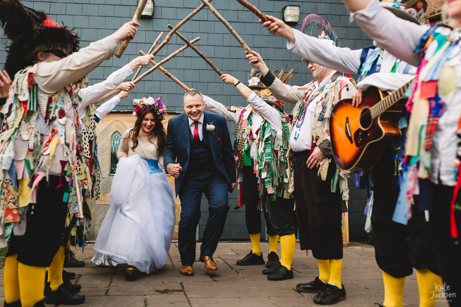 Alternative exit with Morris Dancer arch and the couple running under it at Birmingham Wedding