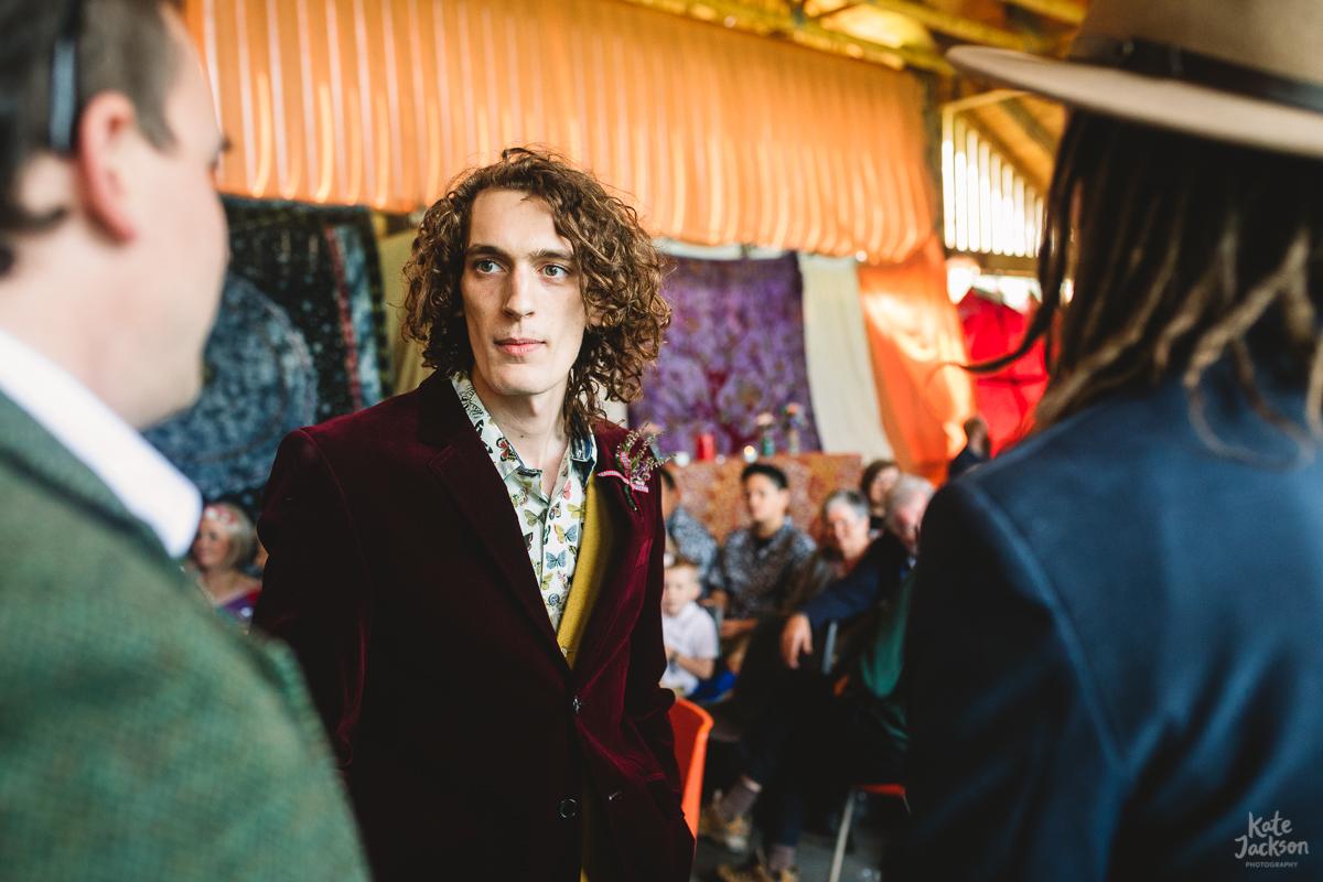 Groom in a fun burgundy velvet suit at festival wedding in Knockengorroch | Kate Jackson Photography