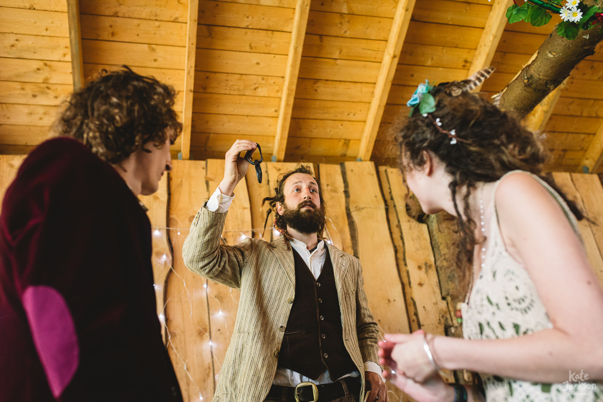Humanist blacksmith festival wedding ceremony, the celebrant is holding a piece of chain link up during the wedding ceremony.