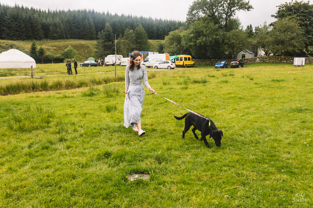 Bridesmaid in a two piece and cute dog at DIY festival wedding | Kate Jackson Photography