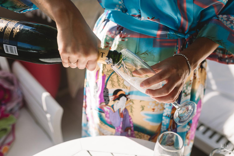 Fun Champagne at Beach Destination Wedding in Skiathos Greece - Kassandra Bay Resorts | Kate Jackson Photography
