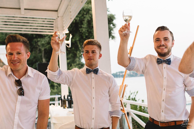 Groomsmen at relaxed beach wedding at Kassandra Bay Resorts