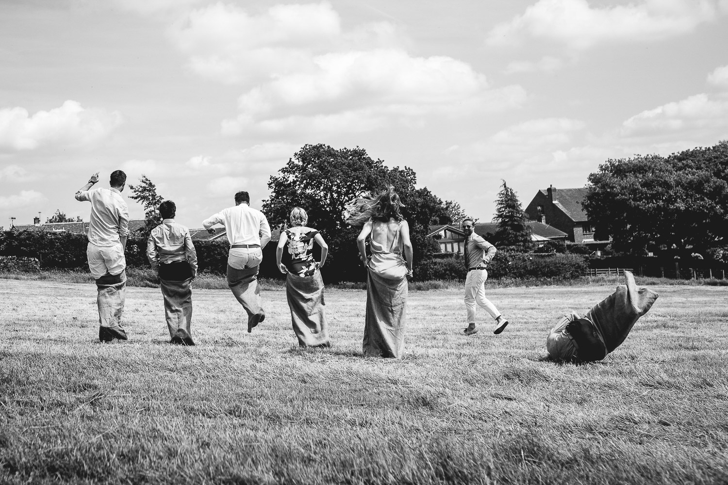 Fun sack racing at outdoor festival wedding in Sheffield