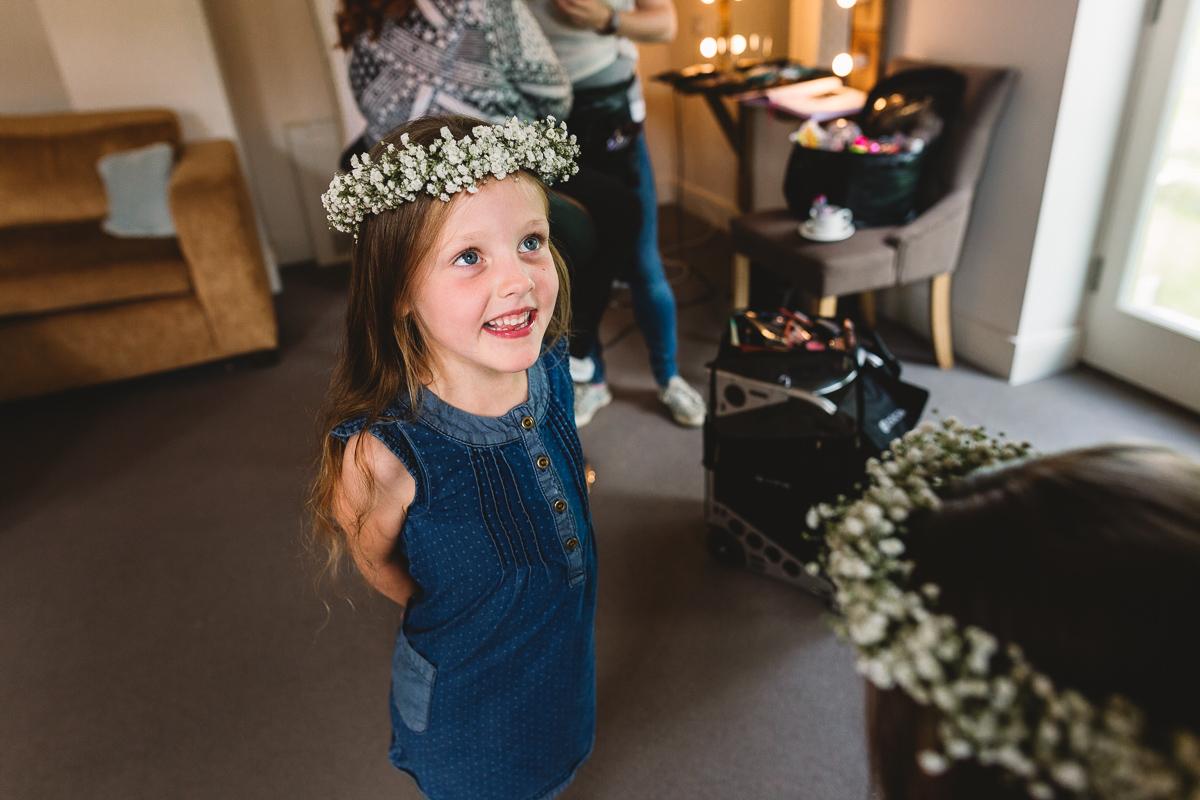 Flower girls with flower crowns at fun hyde barn wedding