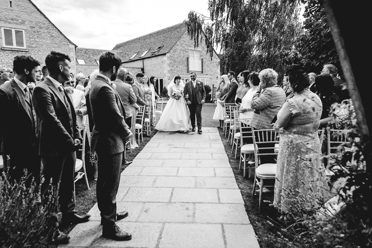Bride in Vintage Lace Dress Walking Down Aisle at Hyde Barn