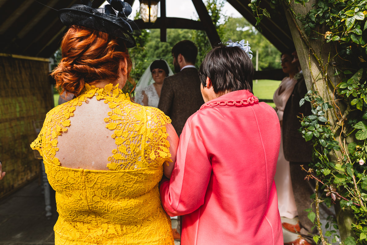 Mothers of the couple watch vows at hyde barn wedding