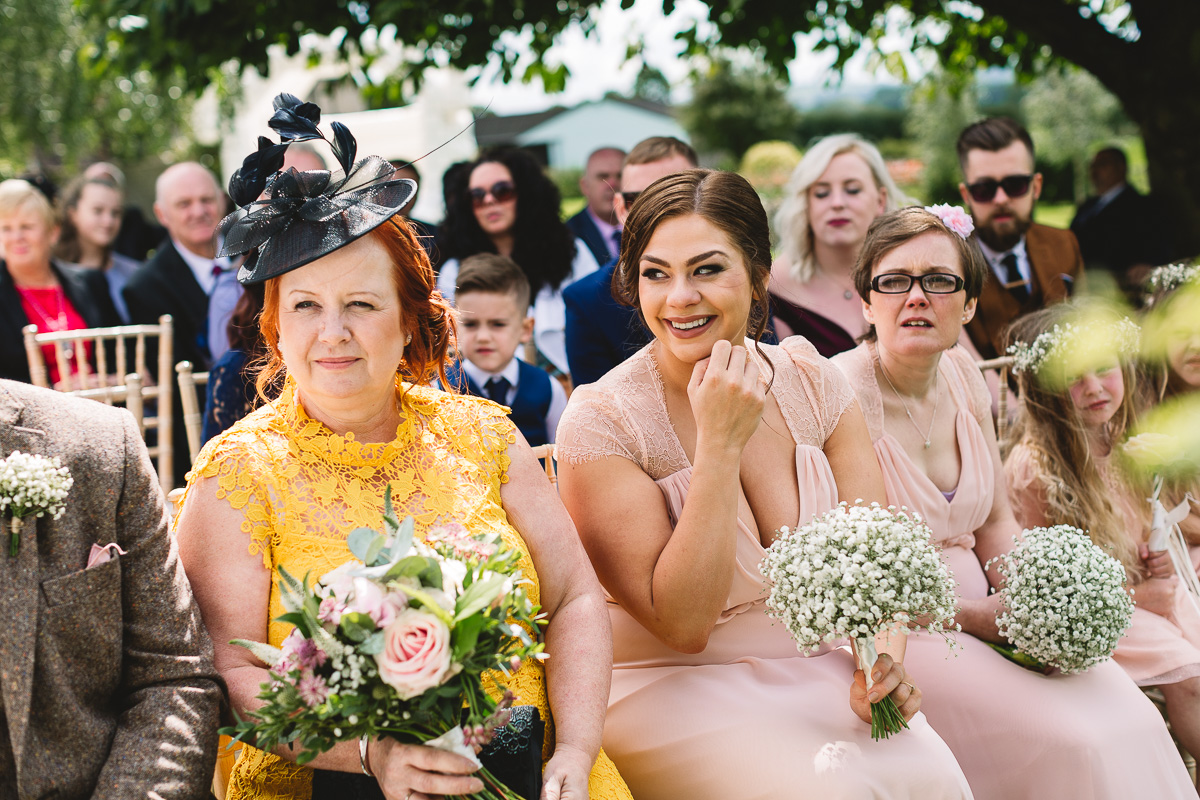 Natural candid photo of bridal party during Hyde Barn Wedding Ceremony