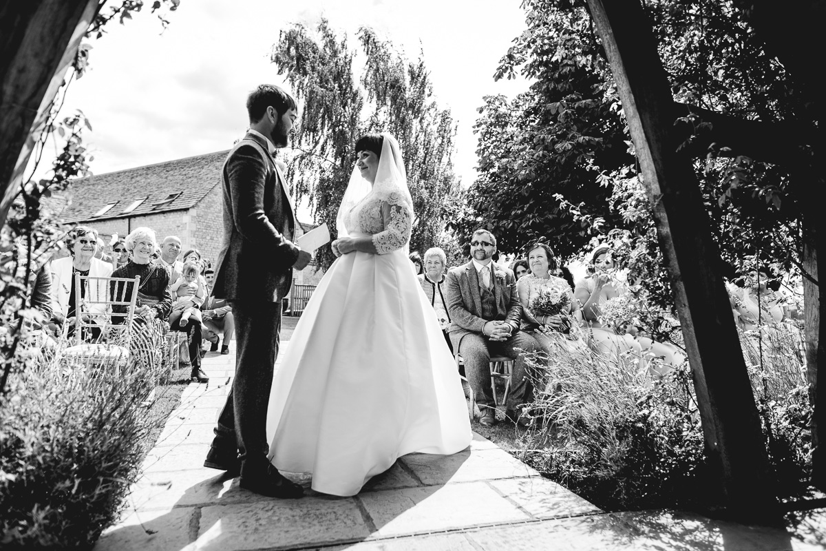 Black and White photo of bride and groom in Hyde Barn wedding ceremony