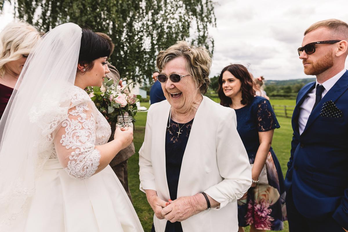 Fun Grandmother laughing at bride | DIY Hyde Barn Weddings