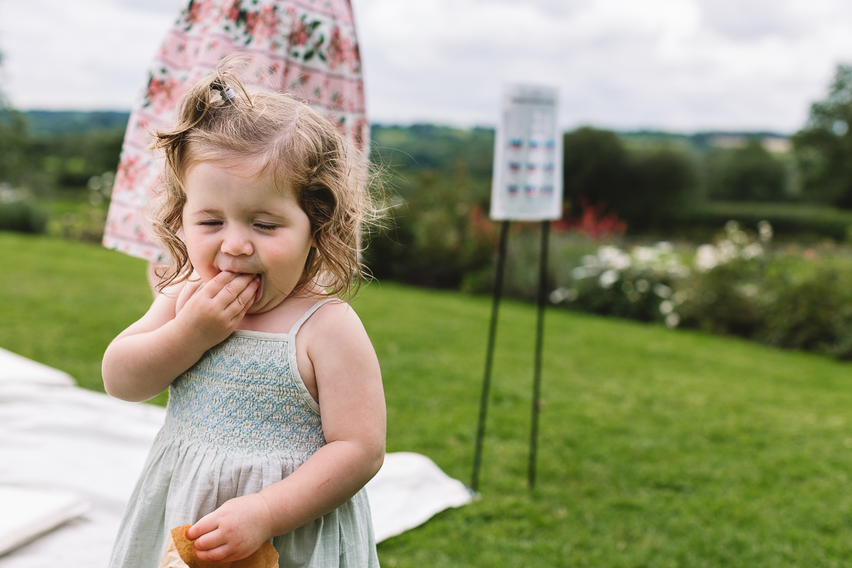 Natural image of kid eating sweet cart sweets | Hyde Barn Weddings