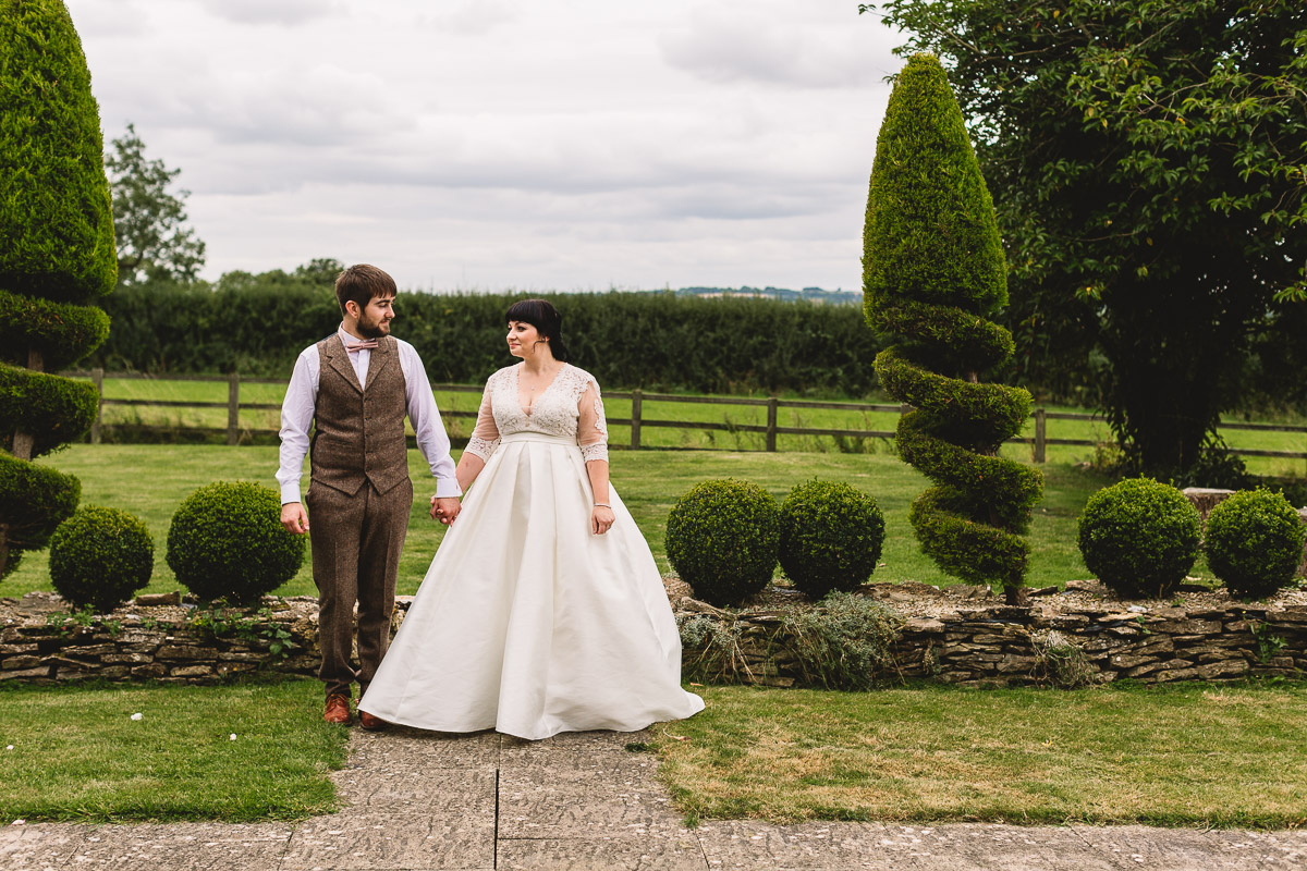 Outdoor wedding photography with bride in a vintage style berketex bridal dress