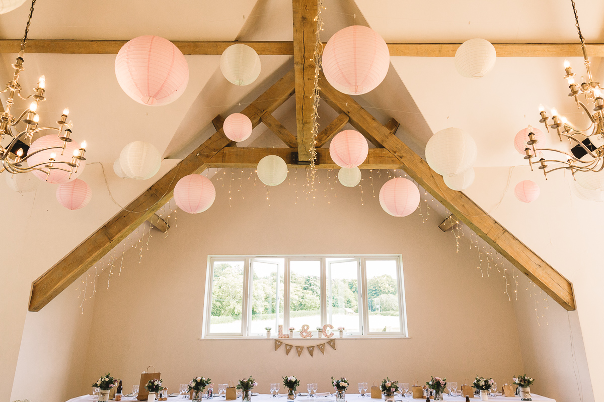 Pink and White Lanterns in the Rustic Hyde Barn