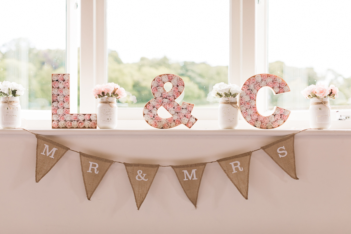 DIY Bride and Groom Initials and fun mr + mrs bunting Hyde Barn Wedding Details