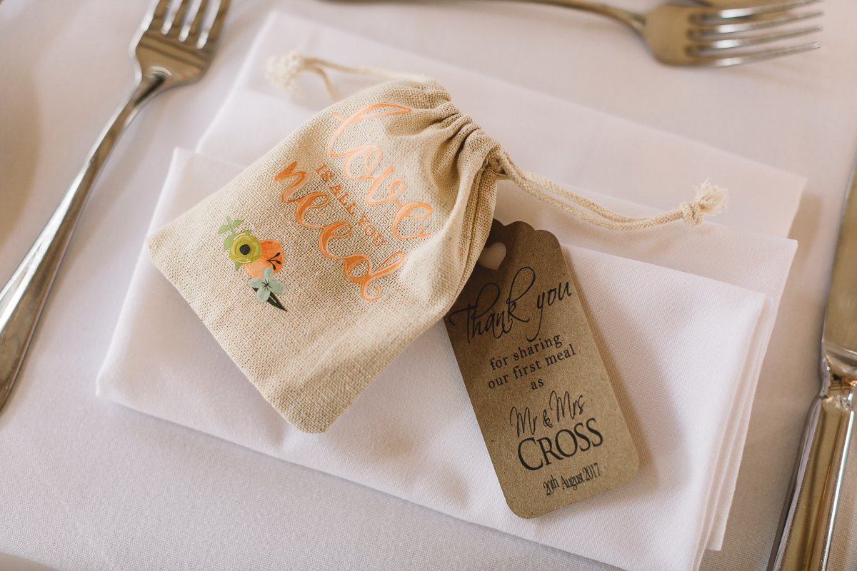 Wedding favour in hessian bag on table at Hyde Barn