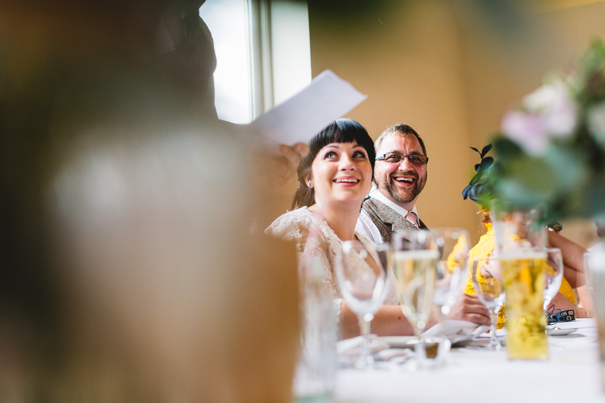Bride smiles at fun & rustic cotswolds wedding | Kate Jackson Photography