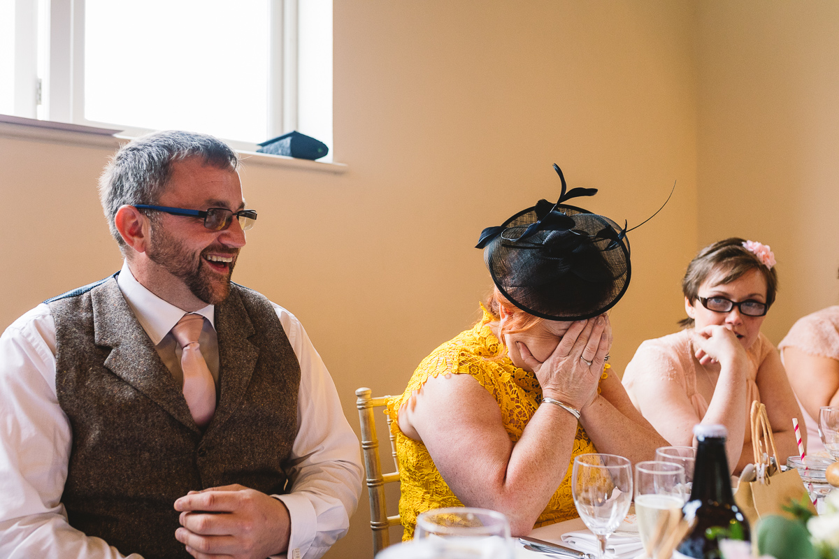Mother of the bride puts head in hands at hilarious and fun best man speech