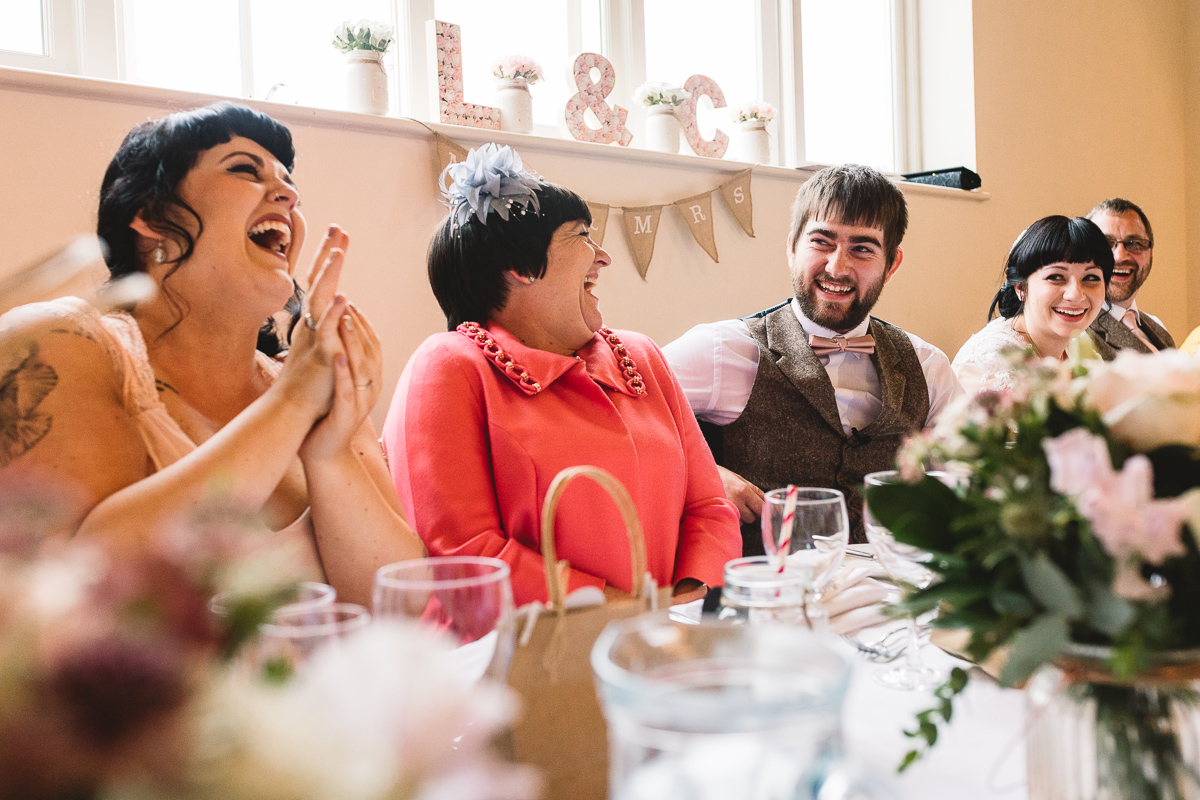People laughing during funny wedding speech | Cotswolds Hyde Barn
