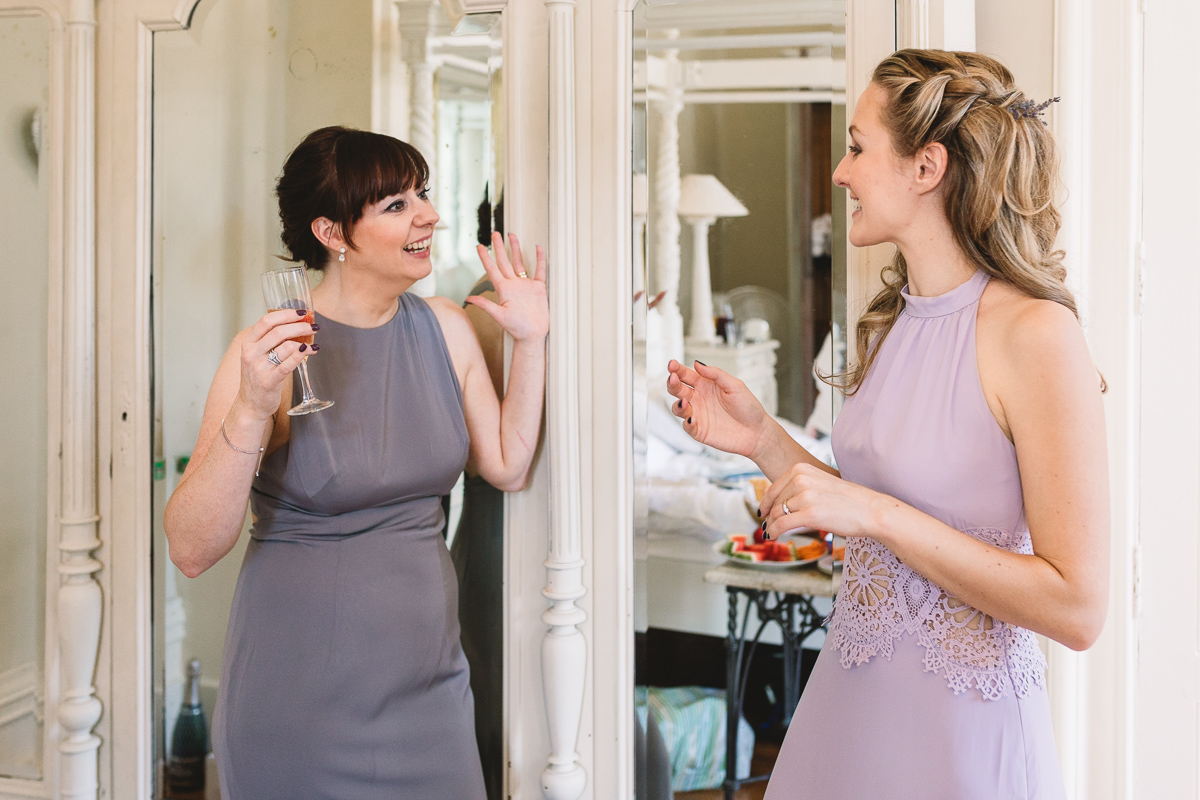 Fun bridesmaids in purple mismatched dresses at french Chateau Wedding