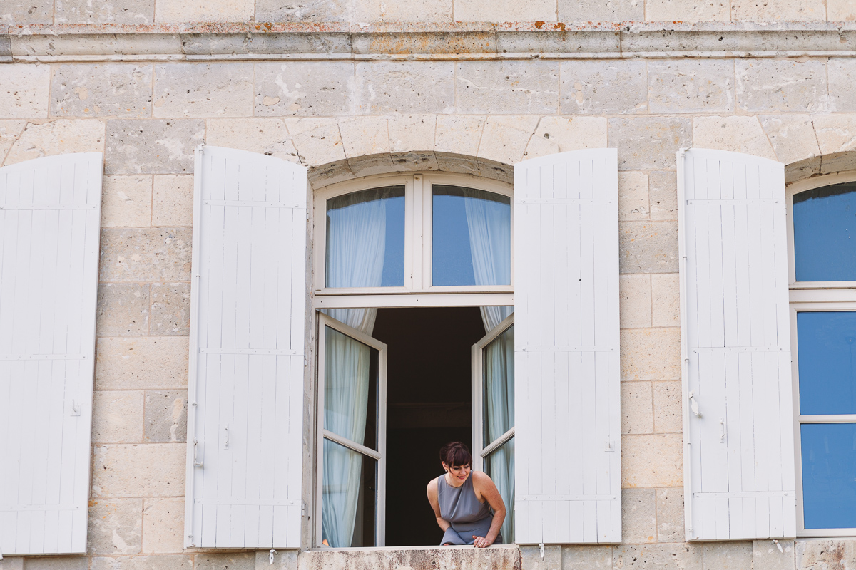 Fun bridesmaid hanging out of window at Chateau Lasfargues wedding