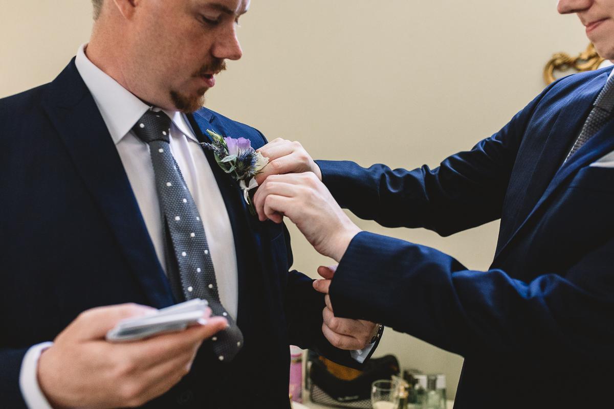 Rustic purple buttonholes at destination wedding france