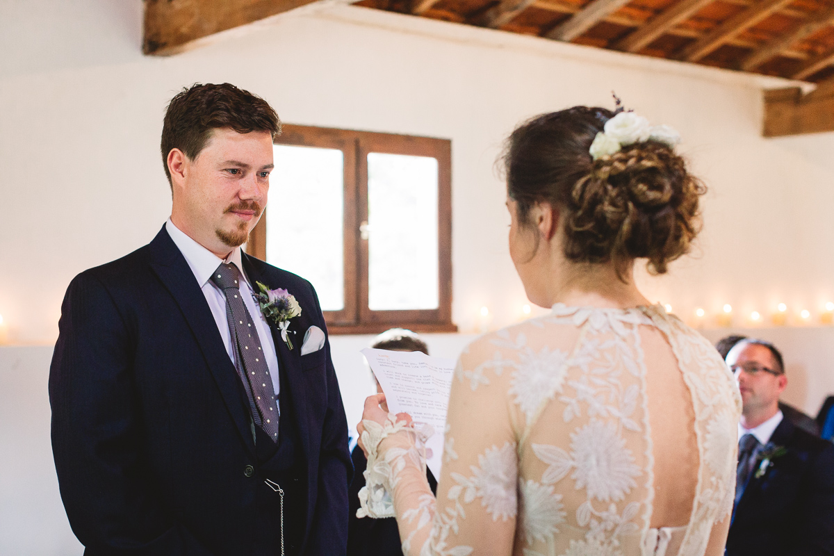 Personalised vows at humanist wedding in french barn