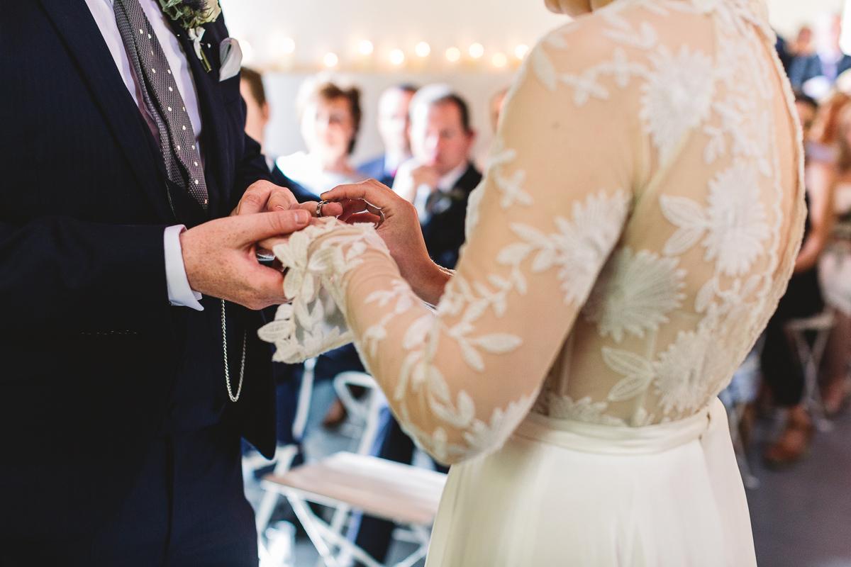 Bride in a Rue De Seine dress in rustic wedding ceremony in france