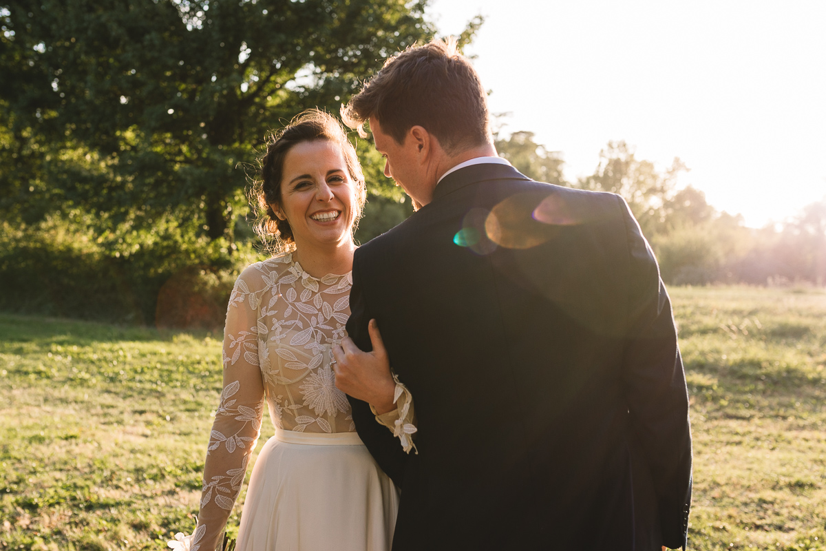 Happy couple at rustic chateau wedding