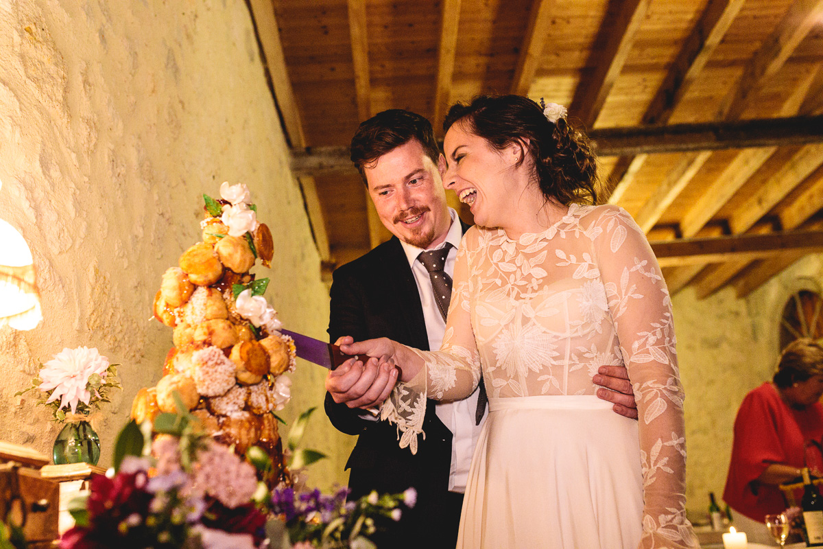 Fun cake cut with croquembouche wedding cake in france